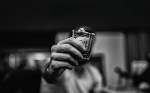 black and white image of person holding cash