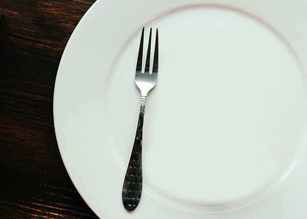photo of empty dish and a dessert fork
